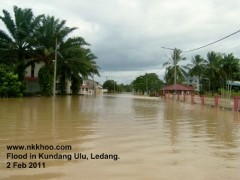 Main street leading to Kundang Ulu Town immersed in the water.
