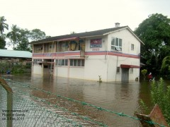 Post office surrounded by flooding water.