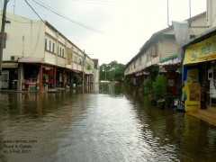 Main street in Gersik town immersed in the water.