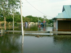 Playground and food stalls are immersed in the water.