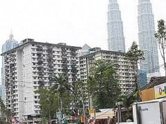 The PKNS flat on the right in Kampung Baru is my first year hostel.