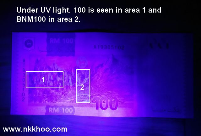 RM100 note under UV light
