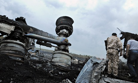 People stand next to the wrecked undercarriage of Malaysia Airlines flight MH17, which was carrying 295 people. Photograph: Dominique Faget/AFP/Getty