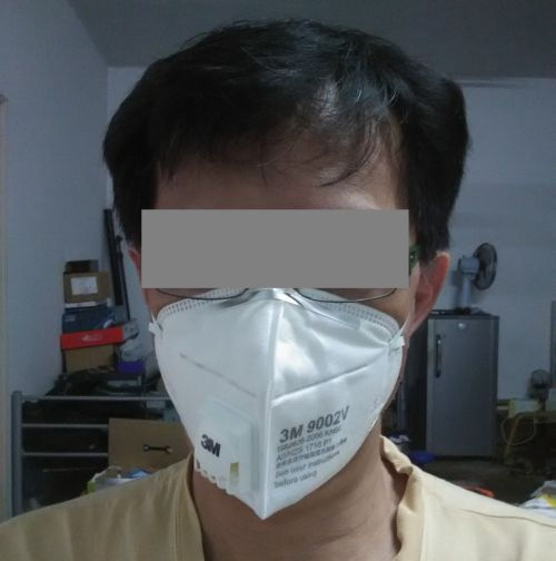 nk khoo with face mask